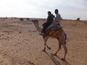 Aaron and a desert guide on a camel