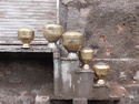 Brass pots drying  on stairs