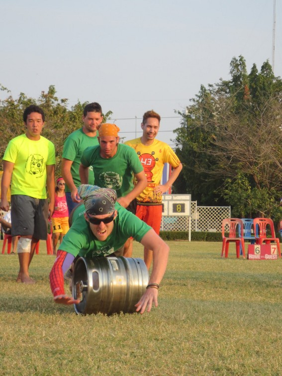 Teammate Chris diving over a keg with me close behind