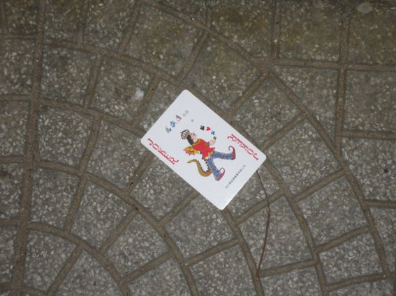 Joker playing card on the street