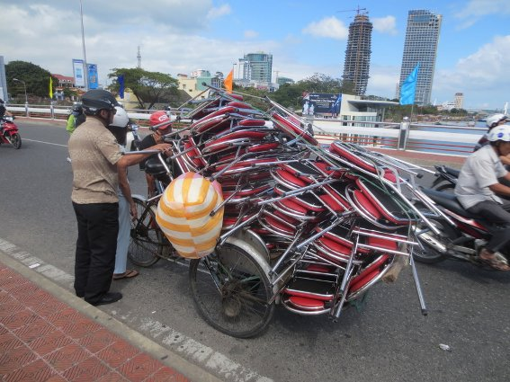 Lots of folding chairs on a tricycle