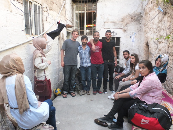 Me and my hosts in Mardin in the courtyard of their old house