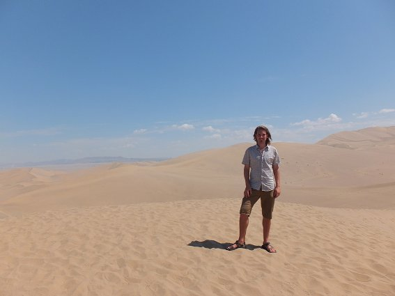 Me on a giant walled-off sand dune by Dunhuang