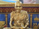 This is a statue made from coating a real human monk in gold after he died. His picture is shown just below the statue.