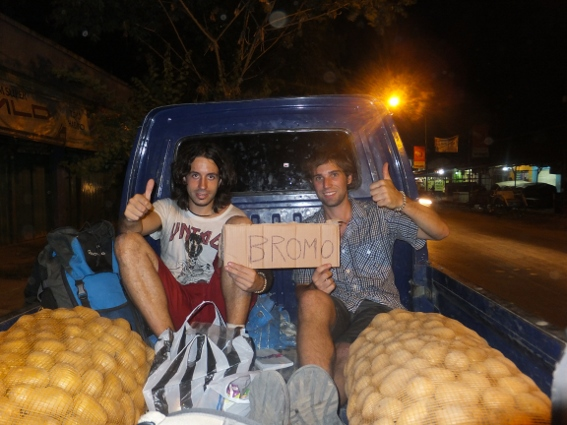 Miguel and I in the back of a farmers truck with two sacks of potatoes