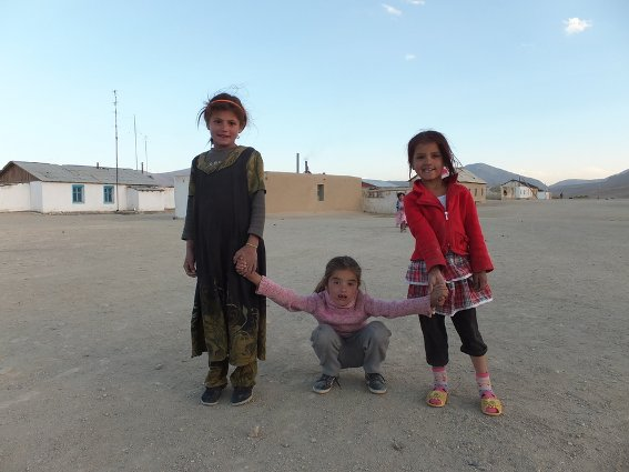 Three girls playing in Bulunkul