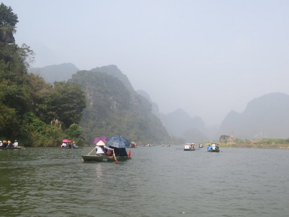 A fleet of tour boats at Trang An