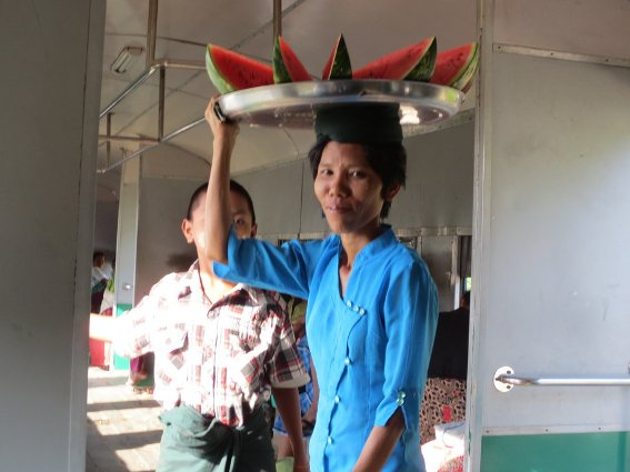 Woman selling watermelon on The Circular Train in Yangon